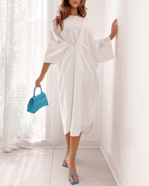 White oversized round neck with buttons details dress