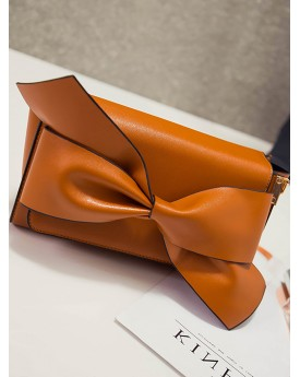 Bow detail faux leather clutch