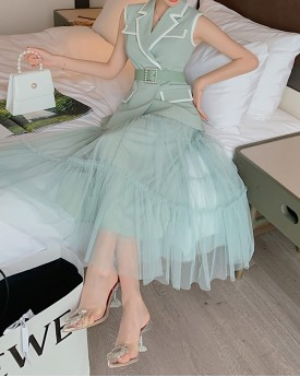 Pastel green vest with pearl belt and tule skirt